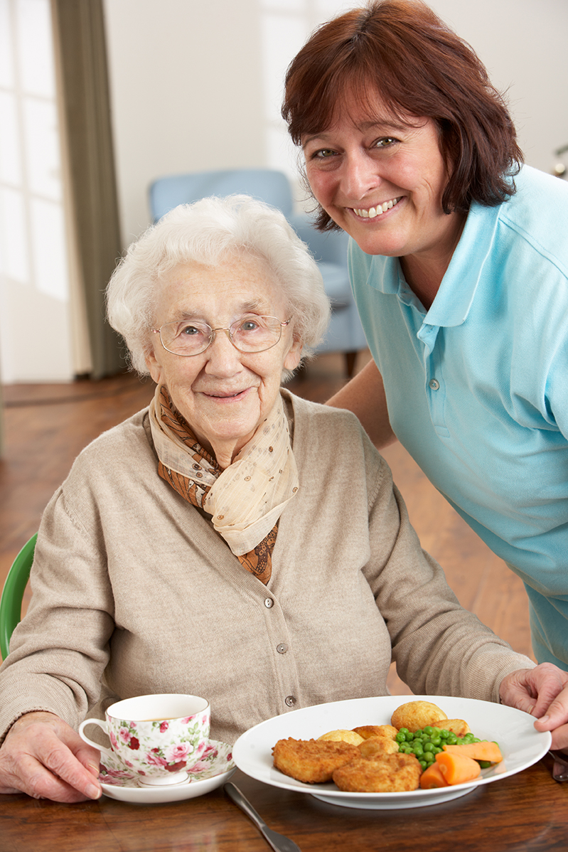 bigstock-Senior-Woman-Being-Served-Meal-15901967