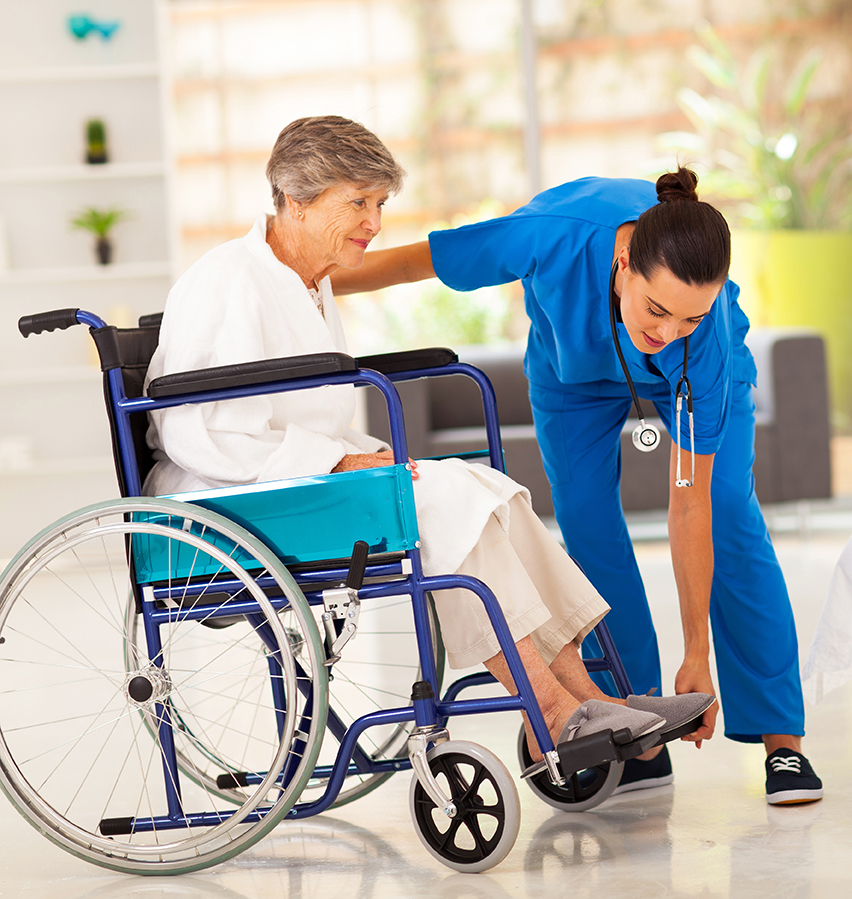 bigstock-young-caregiver-helping-elderl-41561014