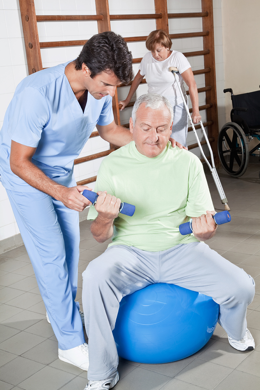 bigstock-Male-Physical-therapist-helpin-34326272