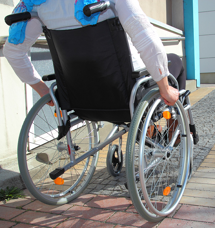 Woman In A Wheelchair Using A Ramp